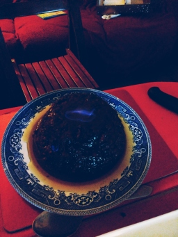 The flaming Christmas Pudding on fire.